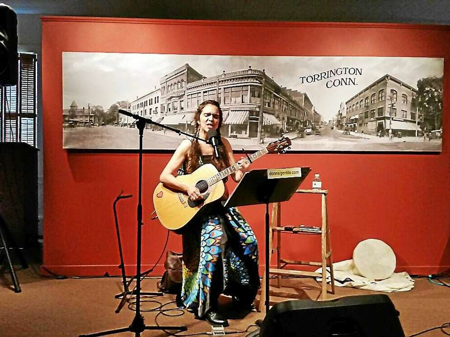 Donna Gentle of Barkhamsted sings original songs at the fourth annual Ladies 'N Lyrics Summer Concert Series on Saturday at the Hotchkiss-Fyler House Museum's carriage house in Torrington. Photo: Photo By N.F. Ambery