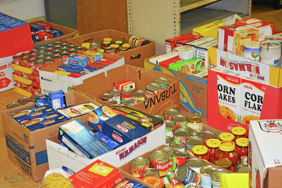 Items such as tuna, pasta sauce, boxed pasta, canned chicken and canned fruit are always high in demand. Photo: Register Citizen File Photo