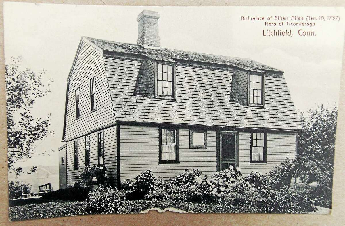 A postcard image of Ethan Allen's birthplace in Litchfield. Today the building has several additions, though the original house still stands and includes the original wooden floors.