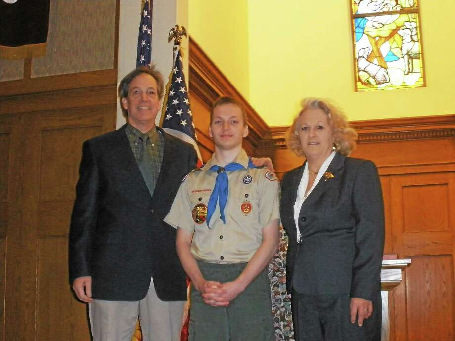 Thomas and Patricia Hafey with their son, William A. Hafey II, at Center Congregational Church in Torrington on Saturday as William was awarded Eagle Scout rank. Photo: Stephen Underwood — Special To The Register Citizen