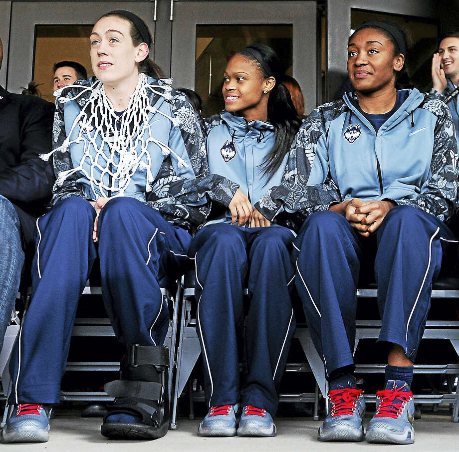 UConn's Breanna Stewart, left, Moriah Jefferson, center, and Morgan Tuck will be saluted before today's game against Tulane as the Huskies hold Senior Night at Gampel Pavilion. Photo: Jessica Hill — The Associated Press  / FR125654 AP