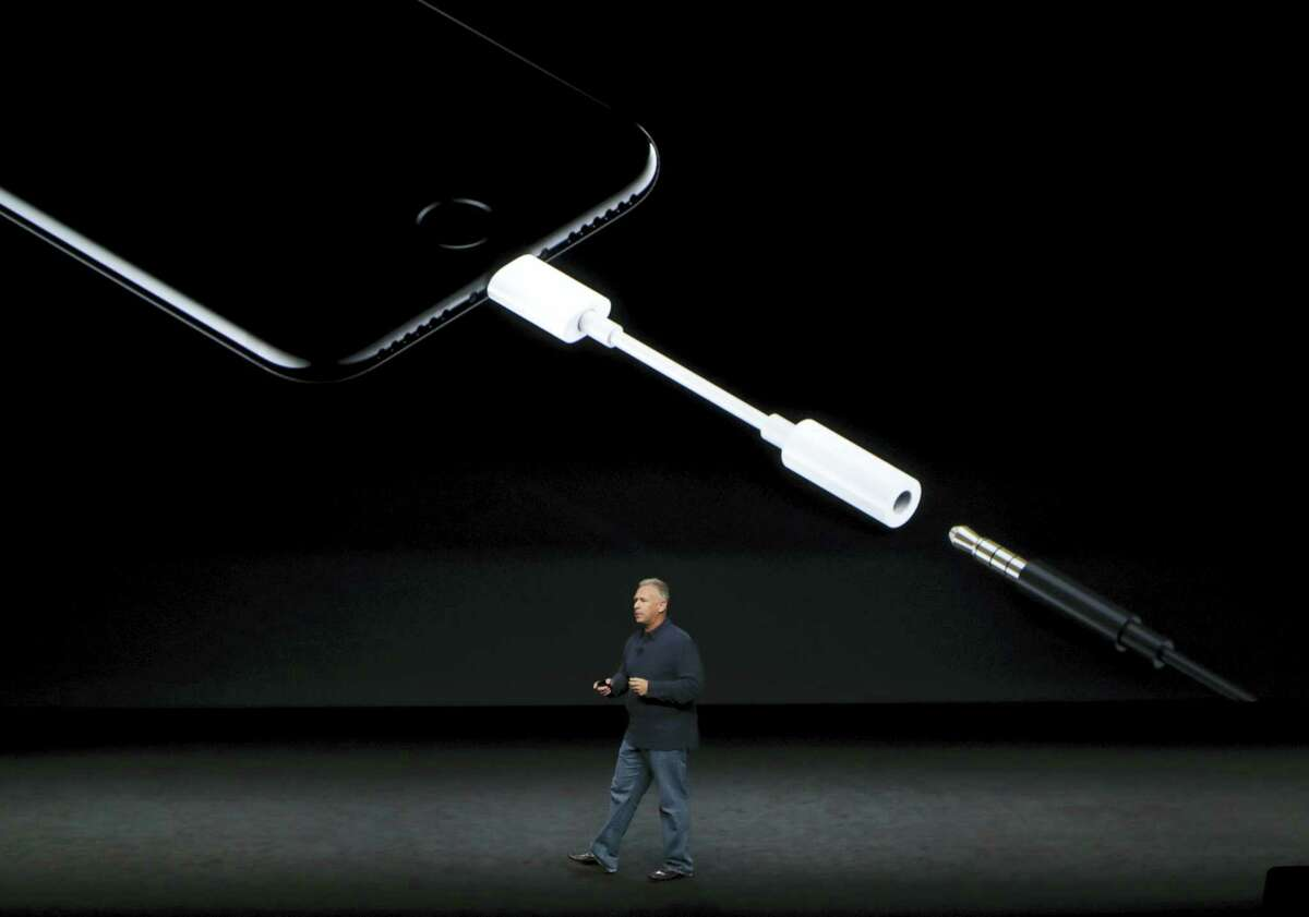 Phil Schiller, Apple's senior vice president of worldwide marketing, talks about the features on the new iPhone 7 earphone options during an event to announce new products, Wednesday, Sept. 7, 2016, in San Francisco. (AP Photo/Marcio Jose Sanchez)