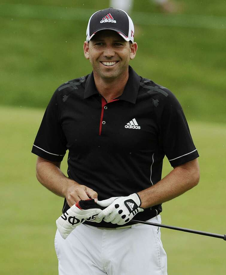 Sergio Garcia smiles on the 18th hole during the third round of the Travelers Championship on Saturday in Cromwell. Photo: Jessica Hill — The Associated Press  / AP2015