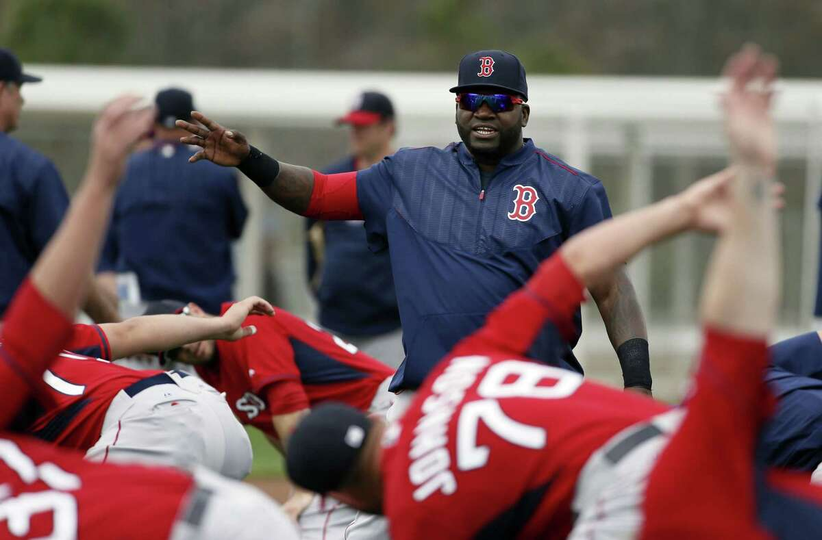 Boston Red Sox DH David Ortiz talks with teammates during stretching on Wednesday in Fort Myers Fla.