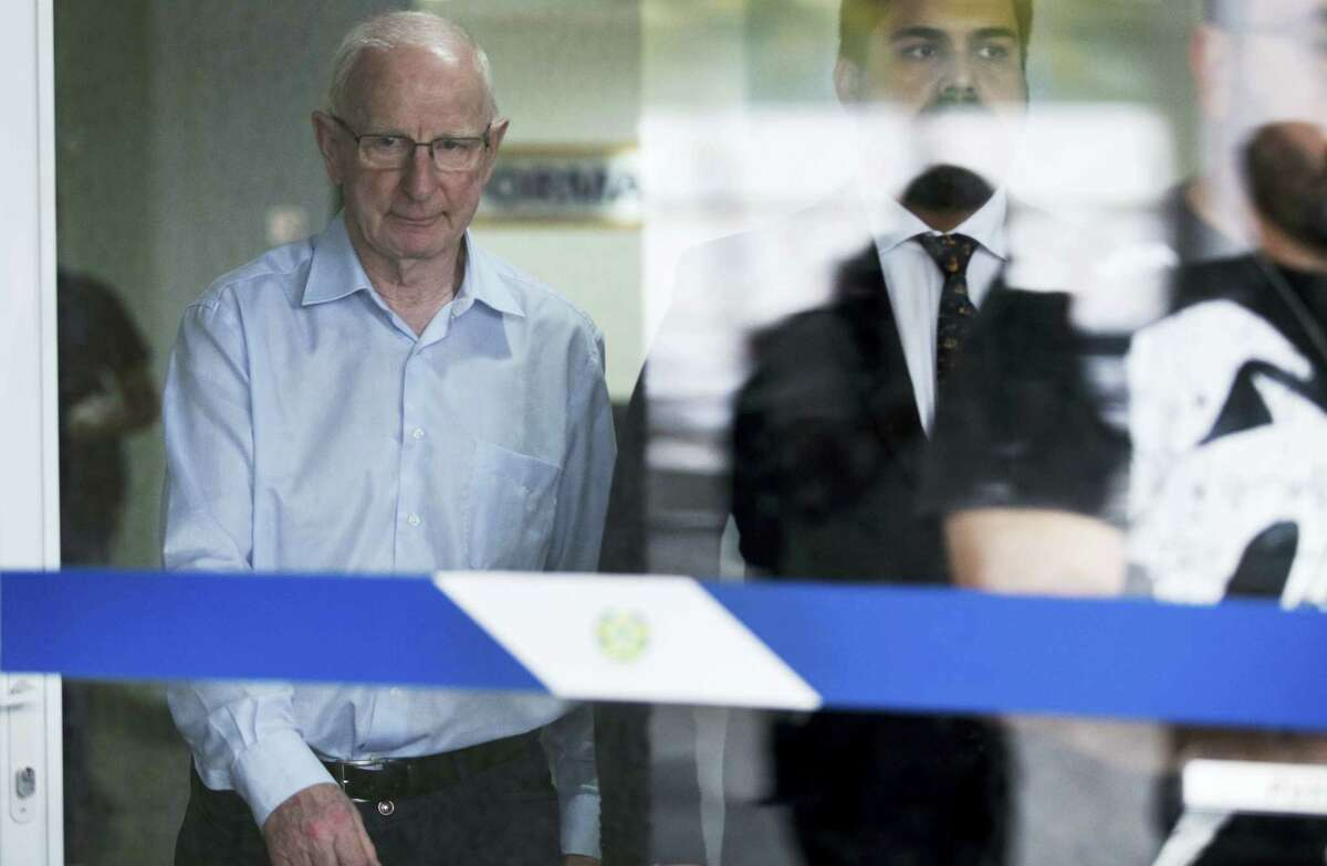President of Ireland's Olympic Council Patrick Hickey, left, leaves a police station in Rio de Janeiro, Brazil on Sept. 6, 2016. Hickey must remain in Brazil until the probe is concluded.