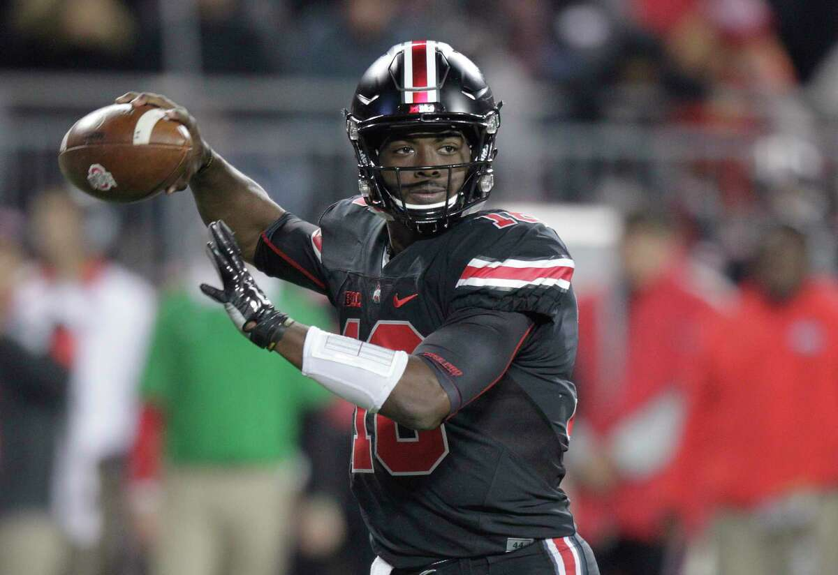 Ohio State quarterback J.T. Barrett drops back to pass against Penn State during the second half of an NCAA college football game on Oct. 17, 2015 in Columbus, Ohio. Ohio State beat Penn State 38-10.