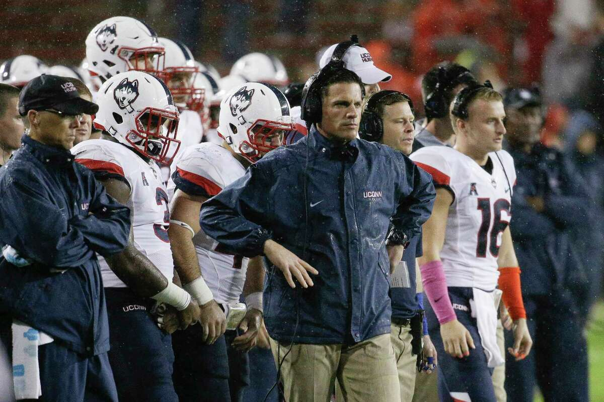 UConn head coach Bob Diaco, center, looks on from the sidelines in the second half against Cincinnati on Saturday,
