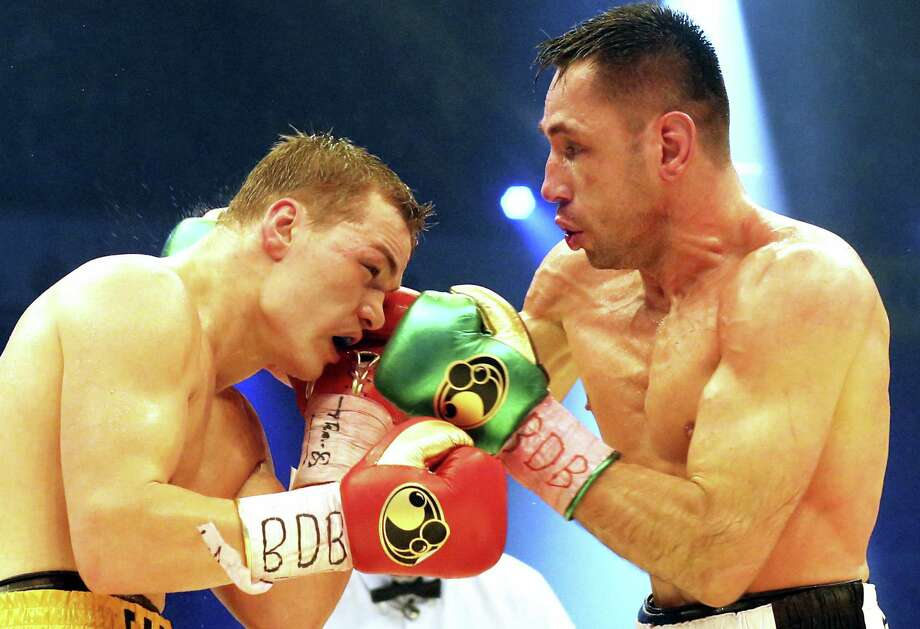 In this Feb. 20, 2016 picture, Germany's Felix Sturm, right, challenges with Russia's Fedor Chudinov, during a WBA super middleweight title bout in Oberhausen, Germany. German prosecutors have opened a criminal investigation against Sturm because of doping. Photo: Roland Weihrauch/dpa Via AP, File  / dpa