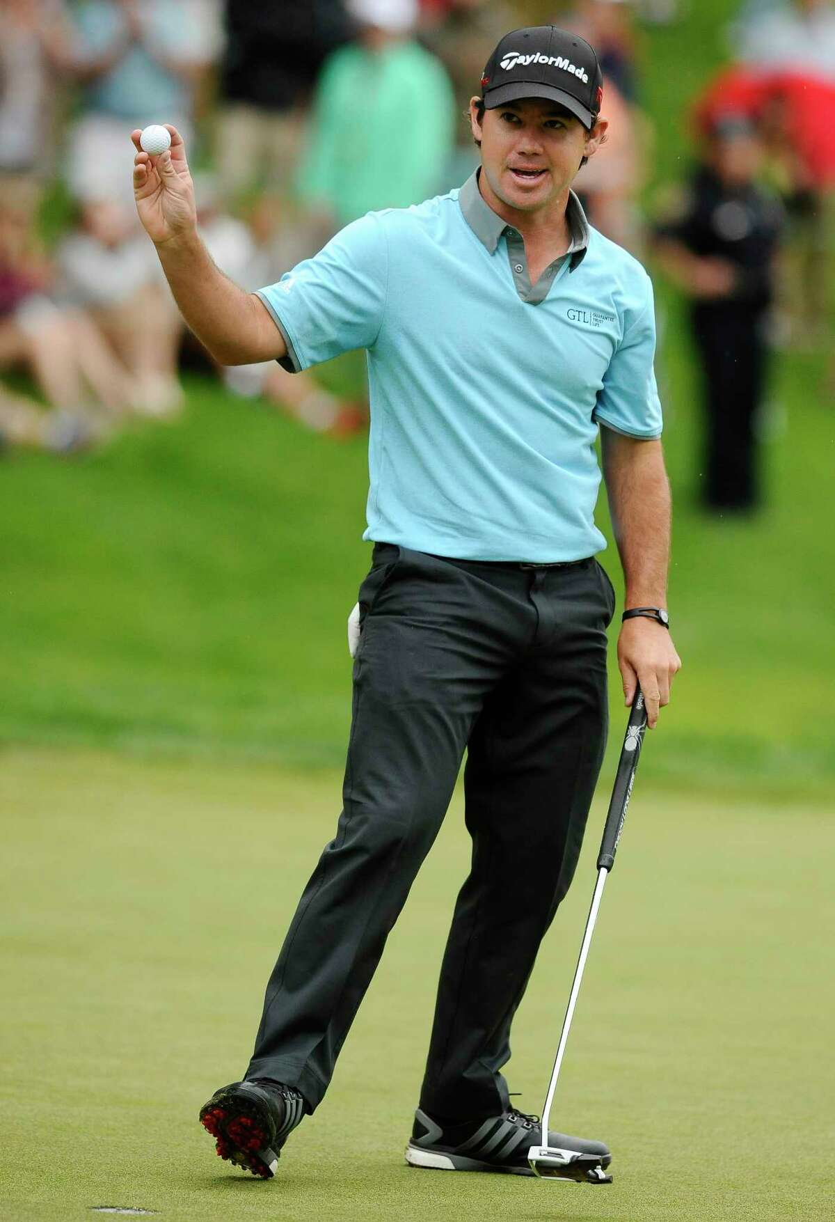 Brian Harman reacts after making a birdie on the 18th and taking the lead after three rounds of the Travelers Championship on Saturday in Cromwell.