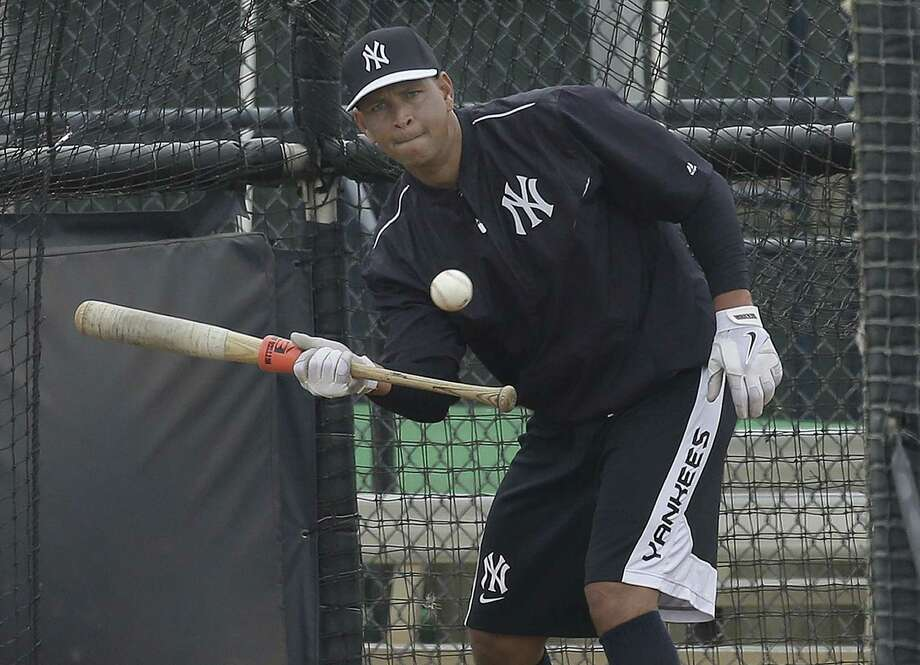 New York Yankees third baseman Alex Rodriguez bunts in the batting cage while working out at the minor league complex on Wednesday in Tampa, Fla. Photo: Chris O'Meara — The Associated Press  / AP