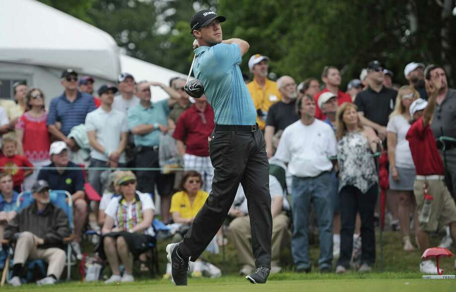 Graham DeLaet tees off on the first hole during the third round of the Travelers Championship on Saturday in Cromwell. DeLaet is one shot off the lead heading into the final round. Photo: Jessica Hill — The Associated Press  / FR125654 AP