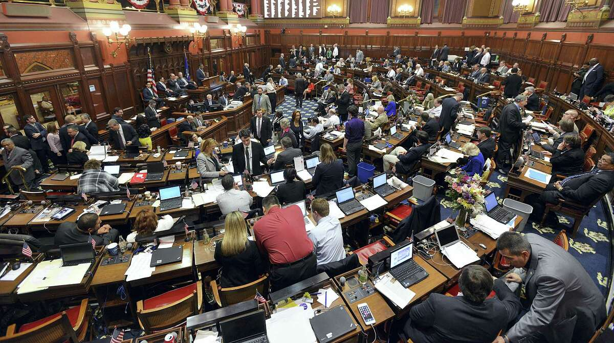 Lawmakers work out small last minute bills during the last day of the legislative session in Hartford, Wednesday, May 4, 2016. Democratic leaders scrapped plans Wednesday evening to push through an 11th-hour budget deal on the final day of the legislative session, acknowledging there was not enough time to pass the bill before a fast-approaching midnight adjournment.