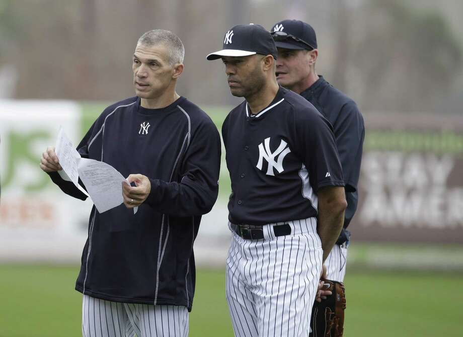 New York Yankees manager Joe Girardi, left, talks with former pitcher Mariano Rivera, right, during a spring training workout on Wednesday in Tampa, Fla. Photo: Lynne Sladky — The Associated Press  / AP