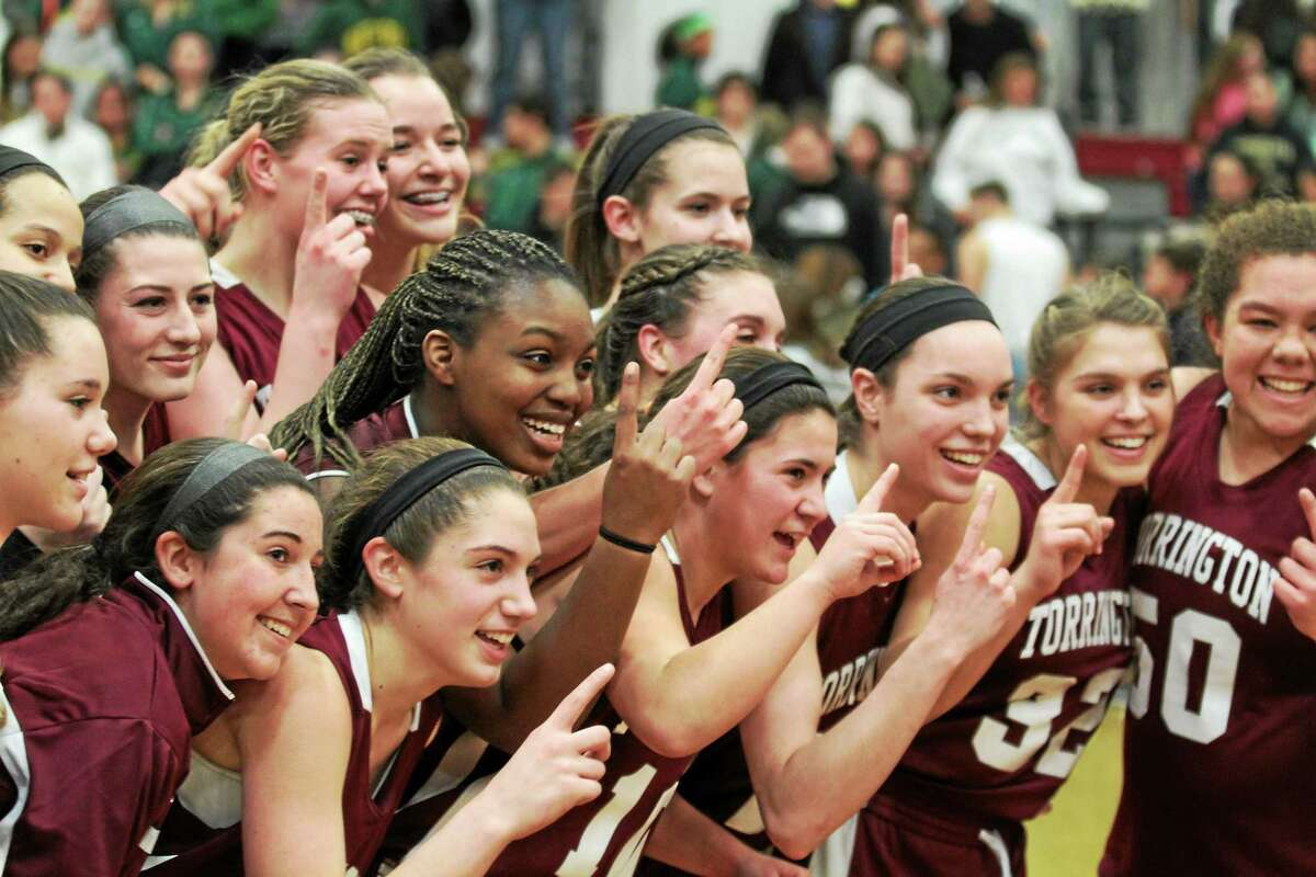 Marianne Killackey -- Register Citizen The Torrrington girls' basketball team celebrates after winning the NVL title.