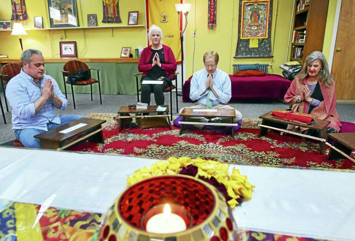 Kris Yaggi of Guilford, Rocky Pickering of Guilford, Paul Gustafson of Madison, and Su Dowling-Slover of Killingworth, after a Red Tara Dedication prayer together at the Buddhist Meditation Center of Guilford.