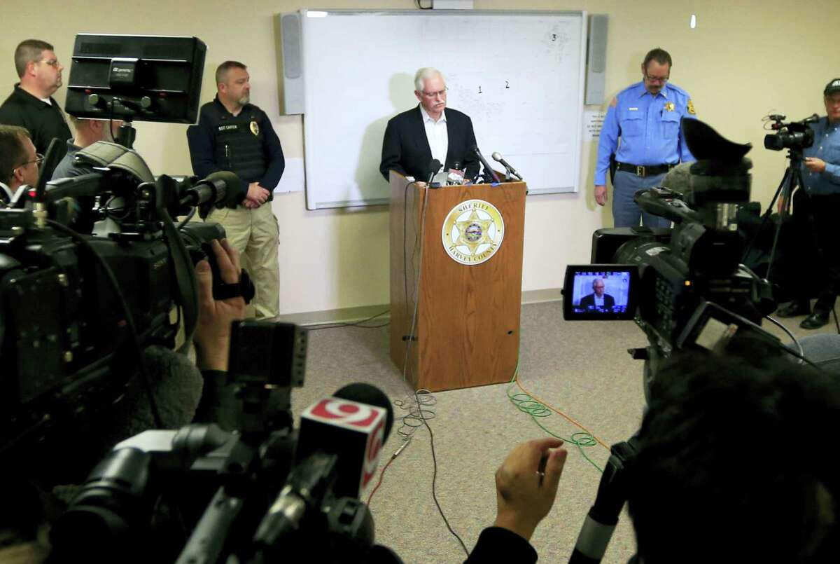 Excel CEO Paul Mullet reads a statement during a news conference at the Law Enforcement Center in Newton, Kan., Friday, Feb. 26, 2016. Mullet offered condolences to the victims of Thursday's shooting at Excel Industries and their families.