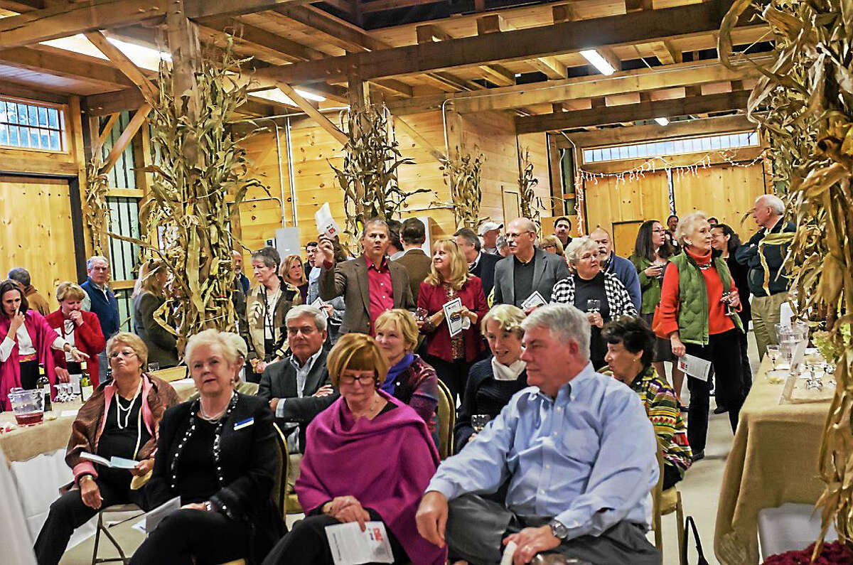 Bidders await the next opportunity at Habitat For Humanity's recent fundraiser.