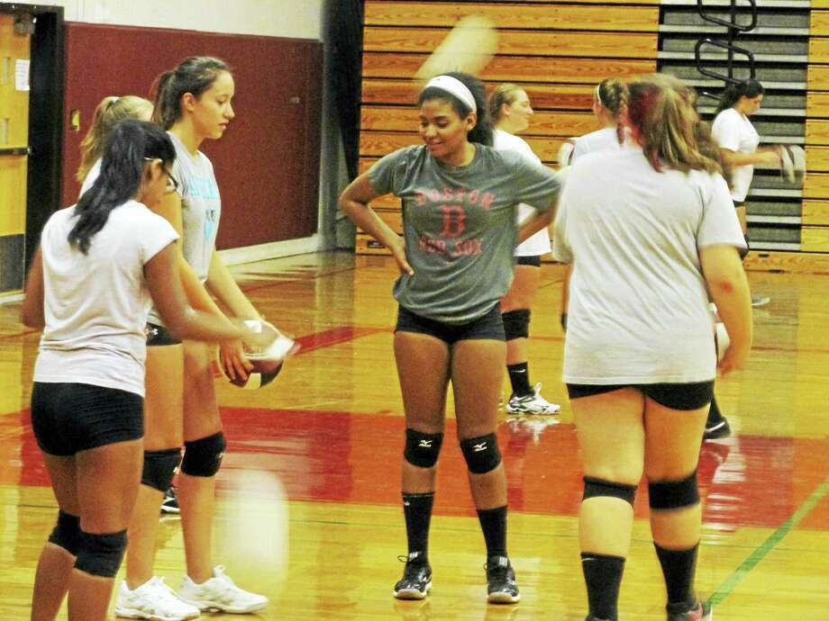 Torrington's girls volleyball program is bolstered by numbers — 13 of its 32 kids are freshmen. Photo: Photo By Peter Wallace