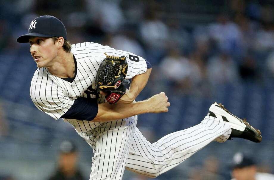 New York Yankees starting pitcher Bryan Mitchell watches a pitch during the first inning against the Toronto Blue Jays on Wednesday in New York. The Yankees won 2-0. Photo: ADAM HUNGER — THE ASSOCIATED PRESS  / FR110666 AP