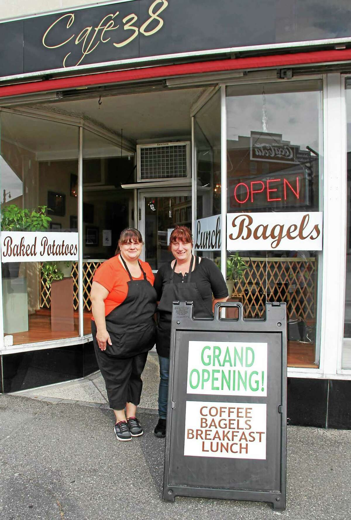 Cafe 38 owners Tina Pesillo, left, and Dawn Vincent outside their new Main Street eatery featuring breakfast and lunch.