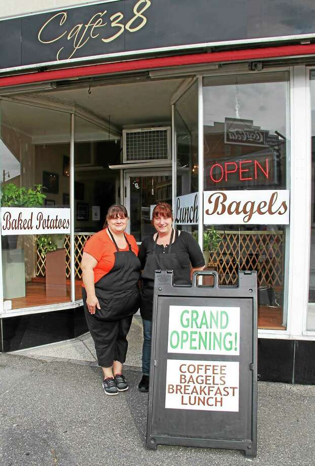 Cafe 38 owners Tina Pesillo, left, and Dawn Vincent outside their new Main Street eatery featuring breakfast and lunch. Photo: Manon L. Mirabelli — The Register Citizen
