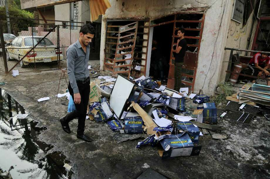 FILE - In this June 10, 2015 file photo, civilians inspect the site of a car bomb attack on Palestine Street in eastern Baghdad, Iraq. Extremists in Iraq, Afghanistan and Nigeria unleashed a savage rise in violence between 2013 and 2014, according to new statistics released by the State Department. Attacks largely at the hands of the Islamic State and Boko Haram raised the number of terror acts by more than a third, nearly doubled the number of deaths and nearly tripled the number of kidnappings.  (AP Photo/Karim Kadim, File) Photo: AP / AP