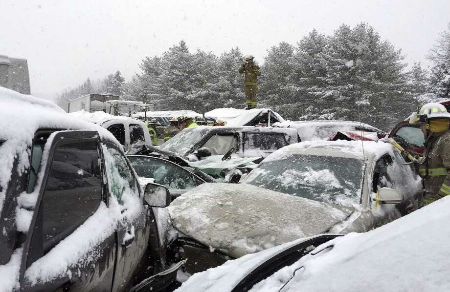 In this photo provided by Maine State Police And Maine Emergency Management, emergency personnel respond to a multi vehicle pileup along Interstate 95 in Etna, Maine, about 20 miles west of Bangor, Wednesday, Feb. 25, 2015.  State police spokesman Steve McCausland said the pileup happened early Wednesday in heavy snow and involved many cars, a school bus and a tractor trailer. No fatalities were immediately reported but McCausland said some of the injuries were serious.  (AP Photo/Maine State Police And Maine Emergency Management, Stephen McCausland) Photo: AP / Maine State Police And Maine Emergency Management