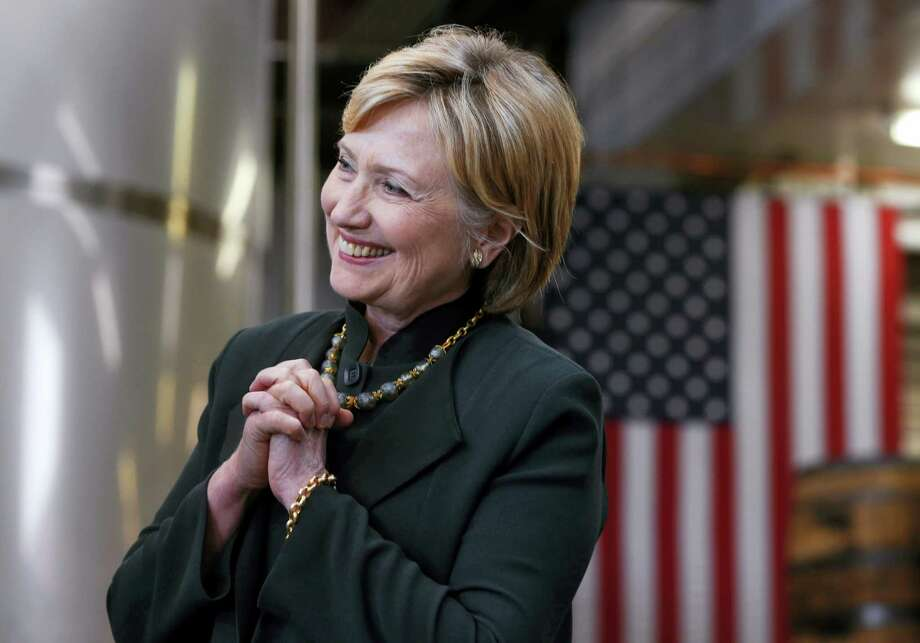 Democratic presidential candidate Hillary Clinton listens during a campaign stop at Jackie O's Production Brewery and Tap Room in Athens, Ohio, Tuesday. Photo: Paul Sancya — The Associated Press  / Copyright 2016 The Associated Press. All rights reserved. This material may not be published, broadcast, rewritten or redistribu