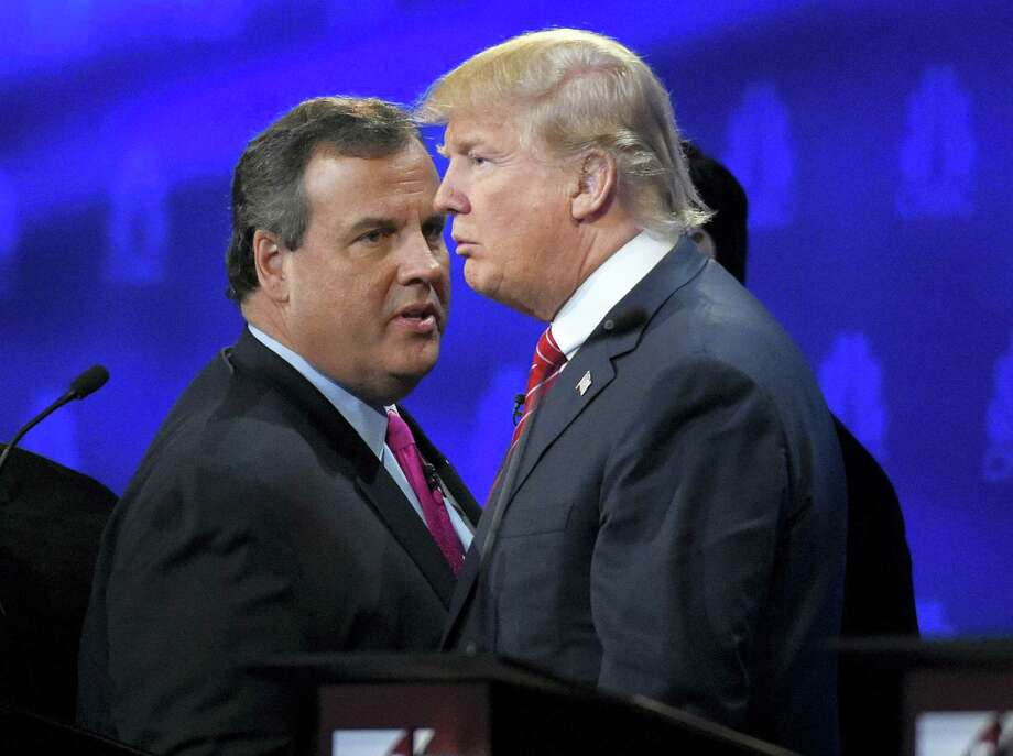 FILE - In this Oct. 28, 2016 file photo, New Jersey Gov. Chris Christie and Donald Trump talk during a break in the CNBC Republican presidential debate at the University of Colorado in Boulder, Colo. Christie had better be hungry: He's got a lot of harsh words to eat about Trump now that he's endorsed the billionaire. Trump, in turn, has some tough things about Christie to start walking back now that the two men are suddenly allies instead of antagonists in the Republican presidential race. Photo: AP Photo/Mark J. Terrill, File / AP