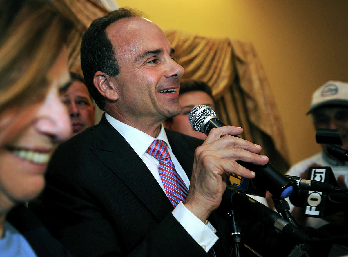 In this Sept. 16, 2015 photo, former Bridgeport Mayor Joseph Ganim addresses his supporters at Testo's Restaurant in Bridgeport, Conn. after winning the Democratic mayoral primary. Ganim served more than seven years in prison before his 2010 release after being convicted on several counts of public corruption. He faces six opponents, but stands a good chance of winning back his old office in the Nov. 3, 2015 general election.