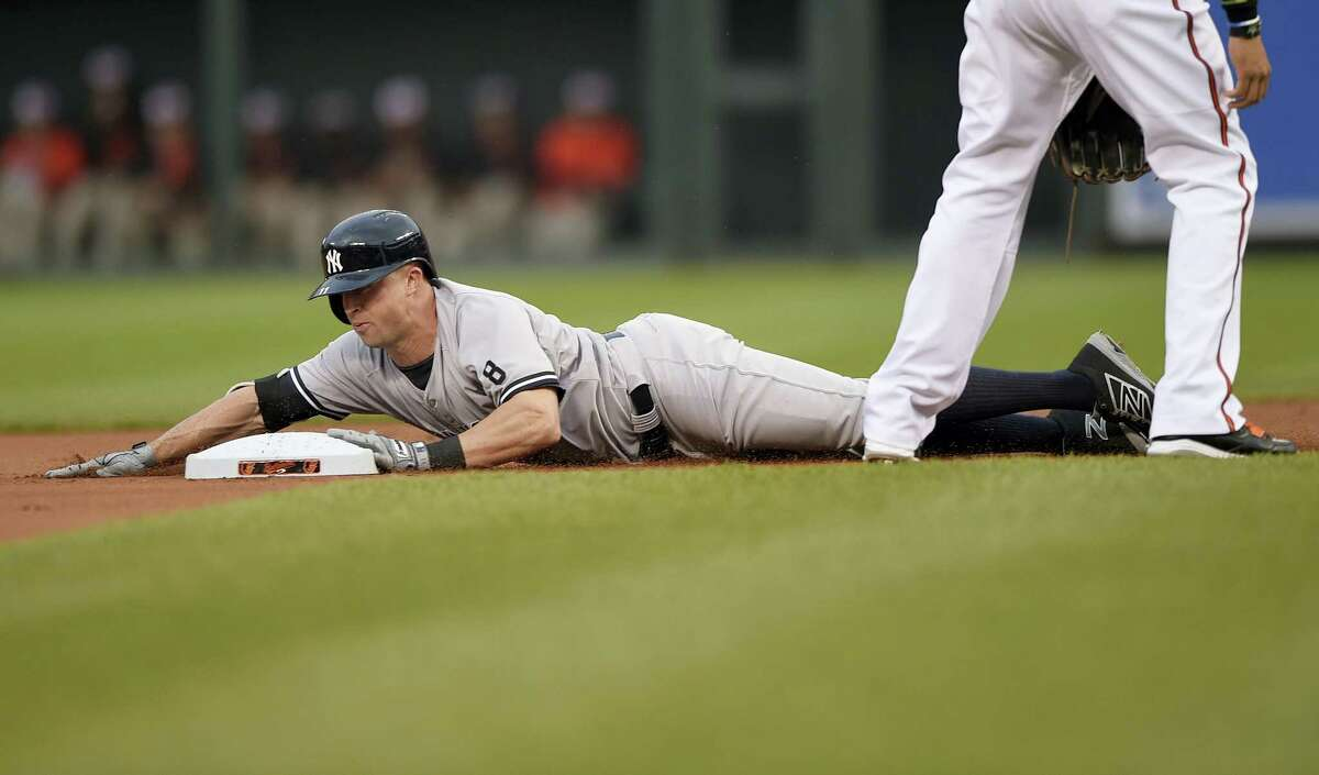 New York Yankees' Brett Gardner slides into second with a double during the first inning Tuesday. The Yankees fell to the Baltimore Orioles 4-1.