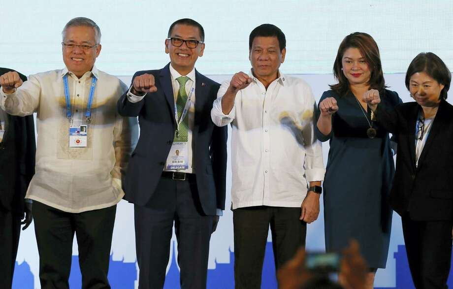 Philippine President Rodrigo Duterte, third from right,  poses with a fist bump with business leaders following his address to ASEAN Business and Investment Summit, a parallel summit in the ongoing 28th and 29th ASEAN Summits and other related summits Tuesday, Sept. 6, 2016 in Vientiane, Laos. Photo: AP Photo/Bullit Marquez   / Copyright 2016 The Associated Press. All rights reserved.