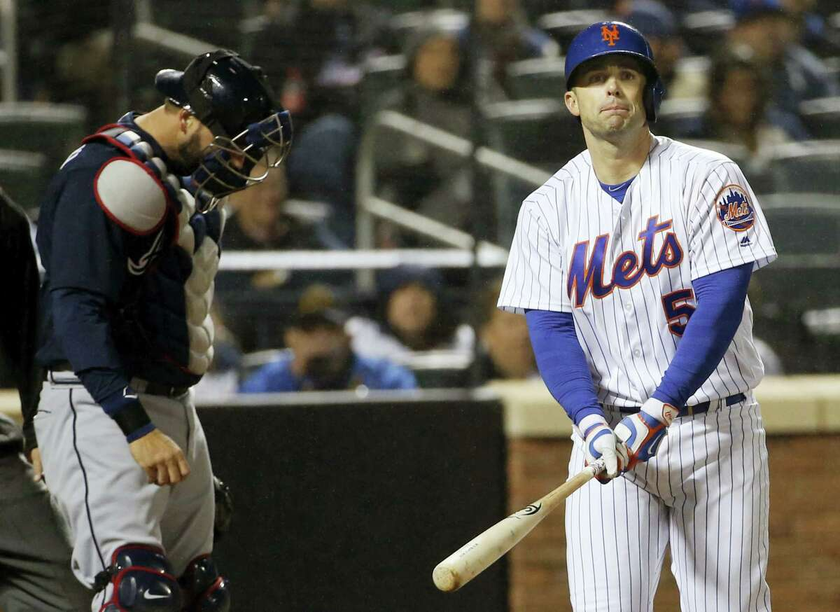 New York Mets David Wright (5) reacts after striking out looking as Atlanta Braves catcher A.J. Pierzynski, left, looks down during the sixth inning of the Mets 3-0 shutout loss to the Braves in a baseball game Tuesday.