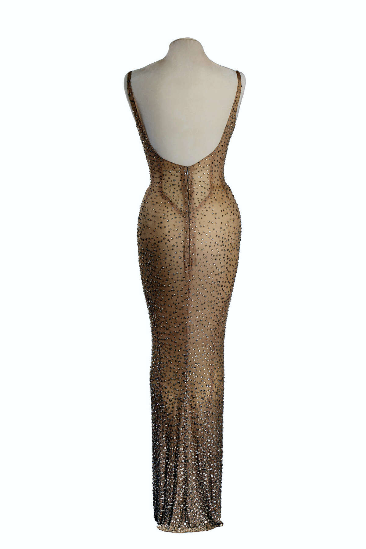 """This undated photo provided by Julien's Auctions shows the back view of the flesh-colored dress Marilyn Monroe wore during her rendition of """"Happy Birthday"""" to President John F. Kennedy. Julien'Äôs Auctions is offering the sequined stunner in Los Angeles on Nov. 17, 2016."""