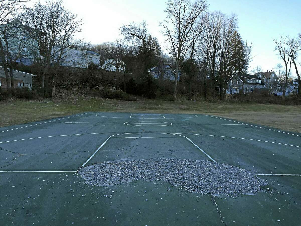 The current basketball court at Borzani Park in Torrington. City officials put out a request Friday for bids to reconstruct the playing surface.
