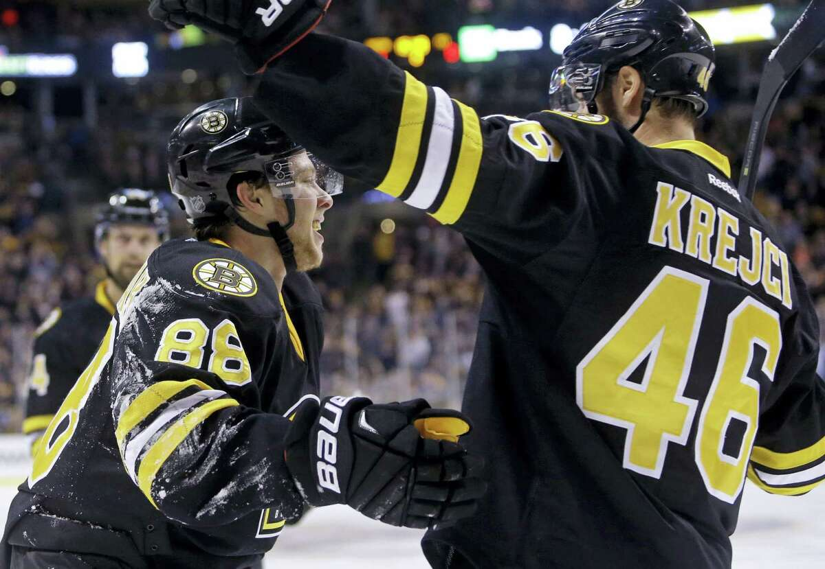Boston Bruins left wing David Pastrnak (88) celebrates his goal against the Pittsburgh Penguins with teammate David Krejci (46) in the second period Wednesday.