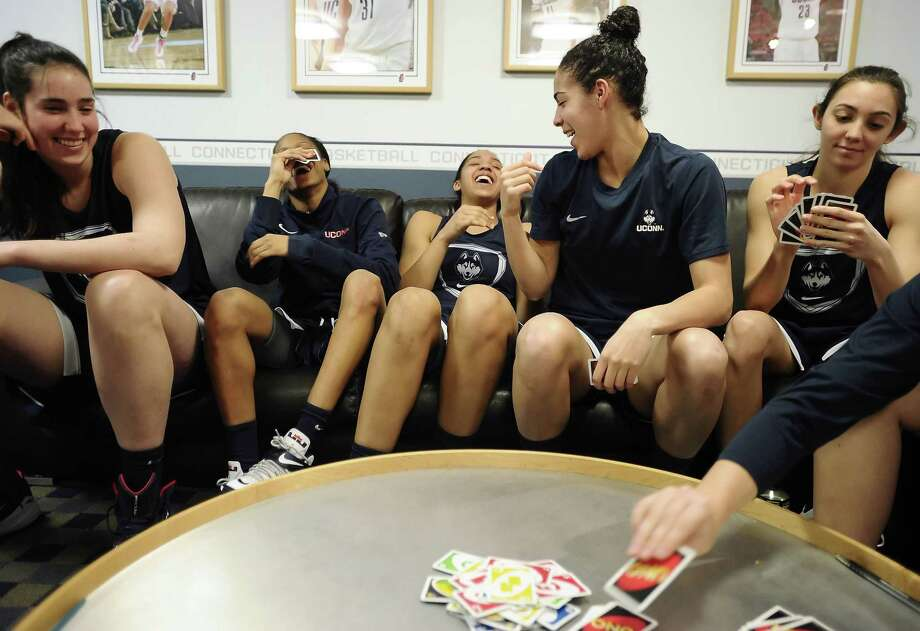 Walk-on Briana Pulido, far right, seen here playing cards with teammates Kia Nurse, second from right, Moriah Jefferson, second from left, and Gabby Williams, center, with Natalie Butler looking on last March, stays busy with her pursuit of medical school. Photo: File Photo - The Associated Press  / FR125654 AP