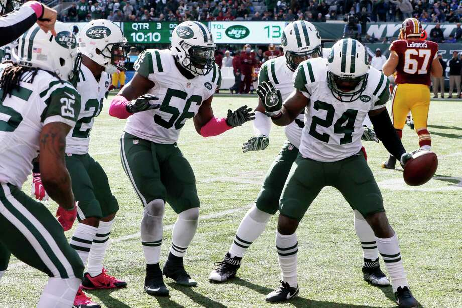Jets players celebrate cornerback Darrelle Revis' interception against Washington last Sunday in East Rutherford, N.J. Photo: Gary Hershorn — The Associated Press  / FR171392 AP