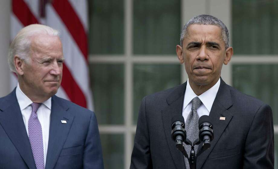 President Barack Obama,  joined by Vice President Joe Biden, pauses as he speaks in the Rose Garden of the White House, Thursday, June 25, 2015, in Washington, about that the U.S. Supreme Court upheld the subsidies for customers in states that do not operate their own exchanges under President Barack Obama's Affordable Care Act. (AP Photo/Carolyn Kaster) Photo: AP / AP