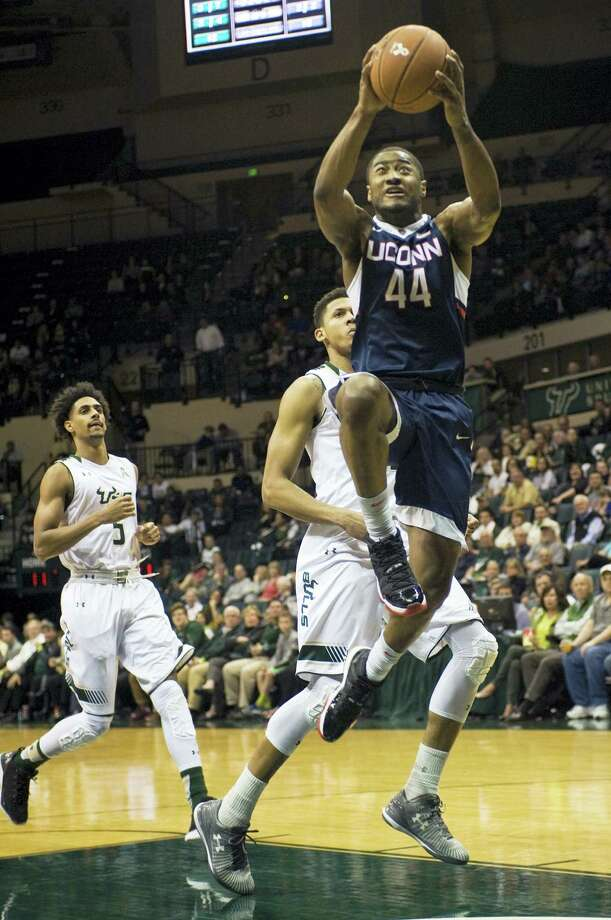 UConn's Rodney Purvis (44) scores past South Florida's Nehemias Morillo (5) and Angel Nunez, center, during the first half Thursday in Tampa, Fla. Photo: Steve Nesius — The Associated Press  / FR69810 AP