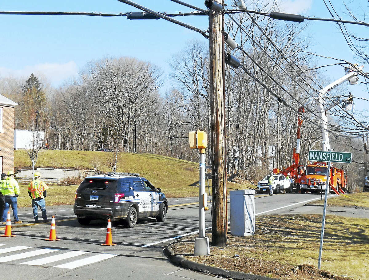 Part of Route 17 was shut down north of Mansfield Drive in North Branford late Thursday morning as crews wroked to repair damage from the strong storm that swept through Greater New Haven the night before.
