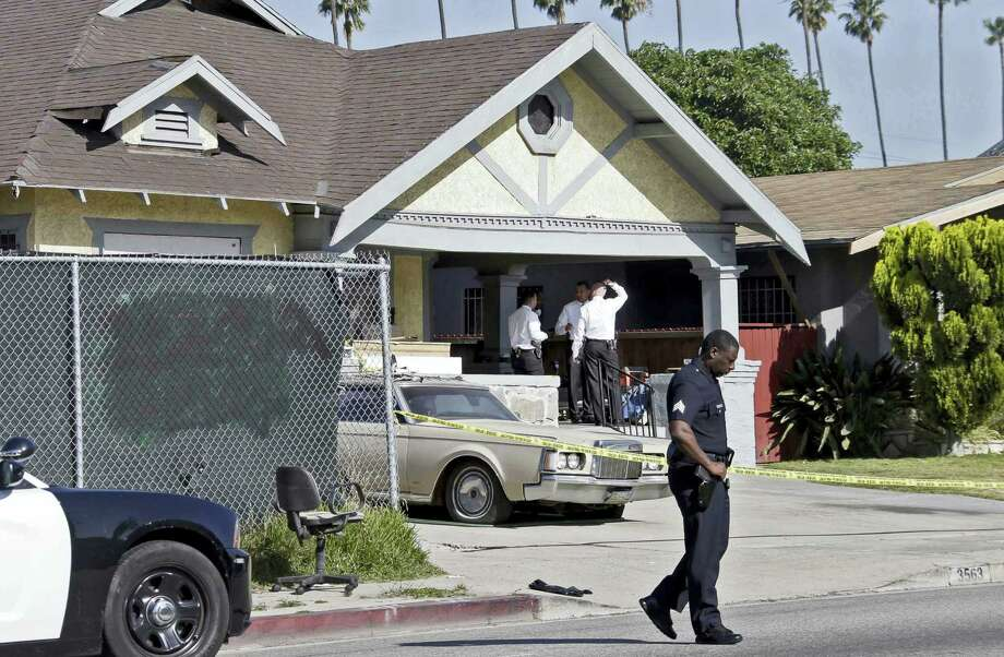 Los Angeles police investigate a stabbing at a house in Los Angeles on Tuesday, May 3, 2016. Donald Gray is suspected of stabbing his live-in girlfriend and her 2-year-old daughter in their home, killing the little girl and critically wounding the mother, who was five months pregnant, authorities said. Photo: AP Photo/Nick Ut   / Copyright 2016 The Associated Press. All rights reserved. This material may not be published, broadcast, rewritten or redistribu