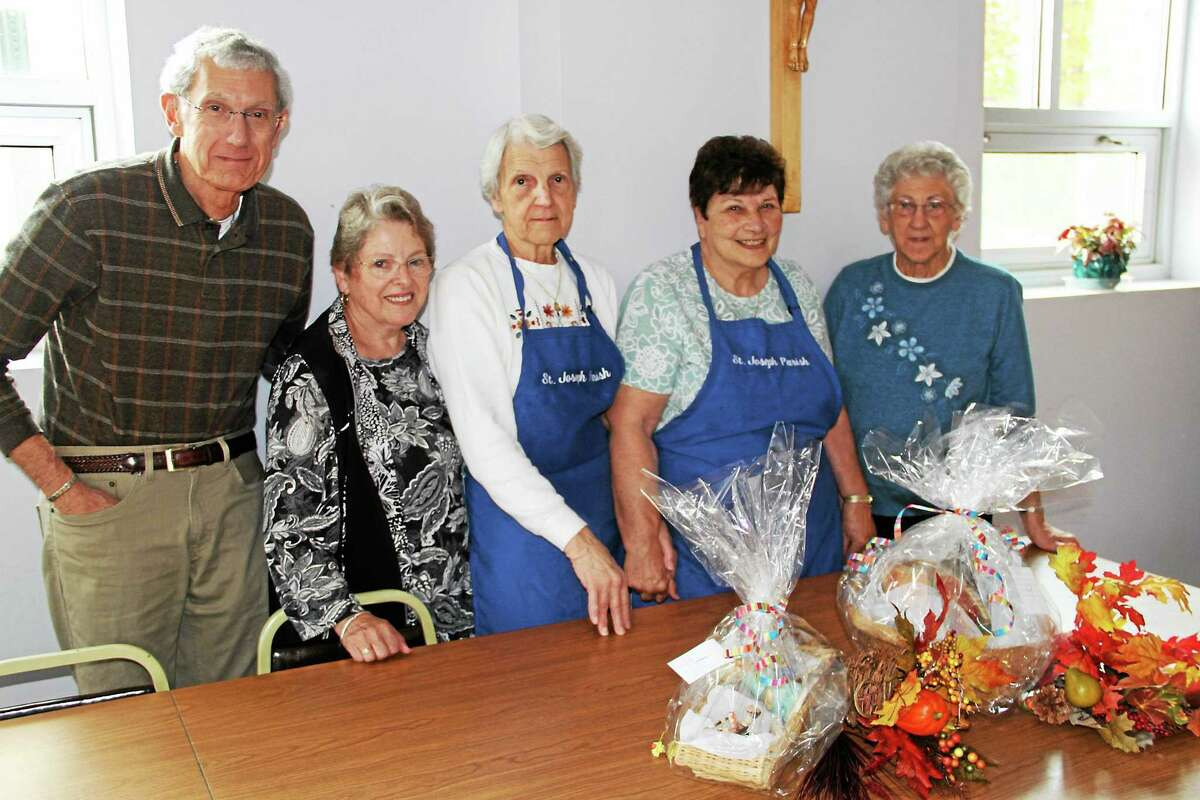 From left, Vinnie and Linda DiBerardino, Frances Dauschere, Ann Brochu and Marguerite Zaccarra are part of the committee that organizes luncheons for senior citizens through St. Joseph Church.