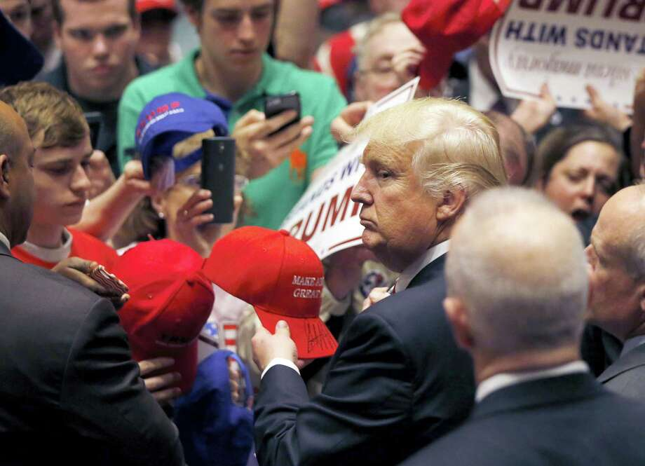 Republican presidential candidate Donald Trump looks at the line of supporters as he works the crowd after a campaign stop Monday in South Bend, Ind. Photo: THE ASSOCIATED PRESS  / Copyright 2016 The Associated Press. All rights reserved. This material may not be published, broadcast, rewritten or redistribu