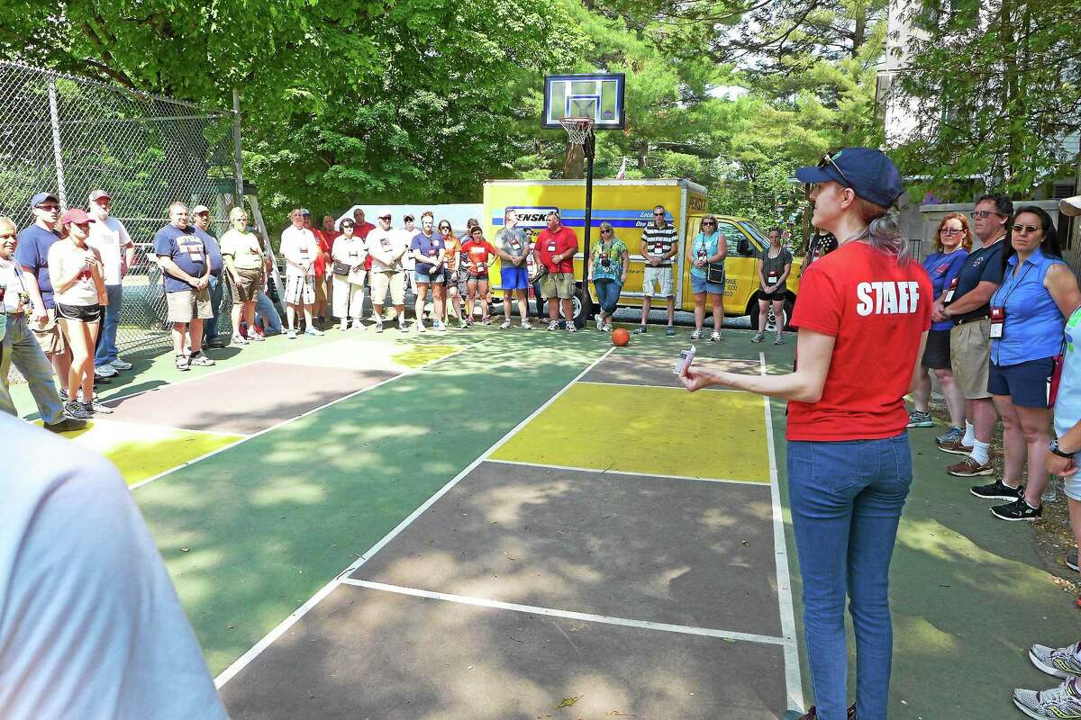 JOHN FITTS — THE REGISTER CITIZEN Jessi Schmale, national community faciltator with Comfort Zone Camp, talks to the big buddies and other adult staff prior to the arrival at the camp for kids affected by a firefighter's death, generally their father.