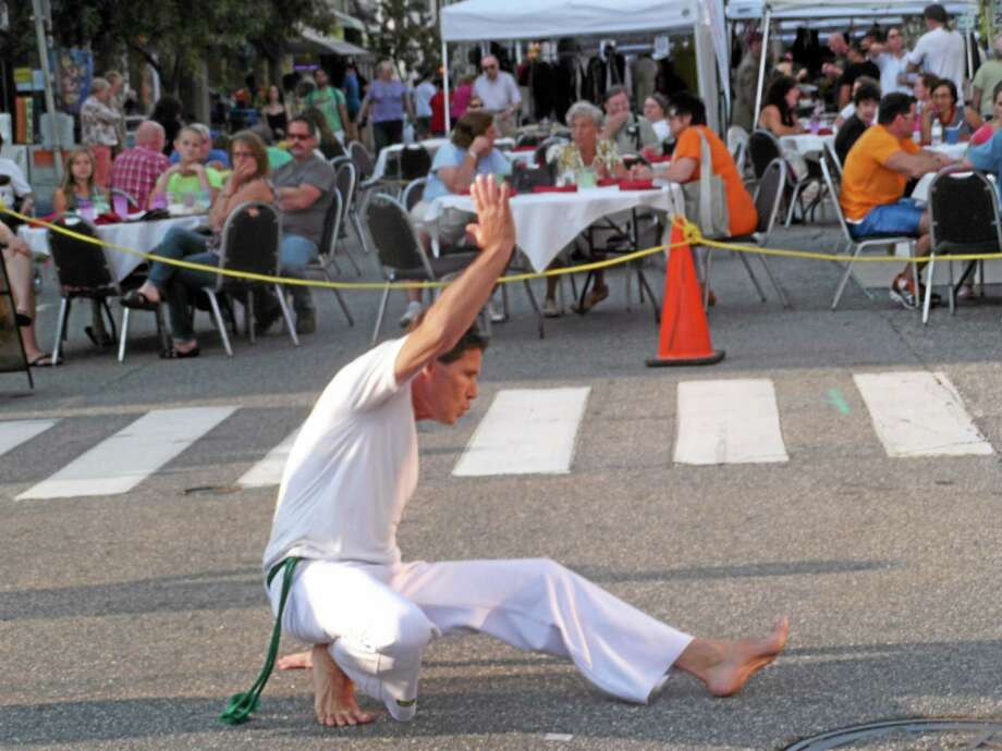 A man dances to Brazilian music at the Main Street Marketplace in Torrington. Photo: Register Citizen File Photo