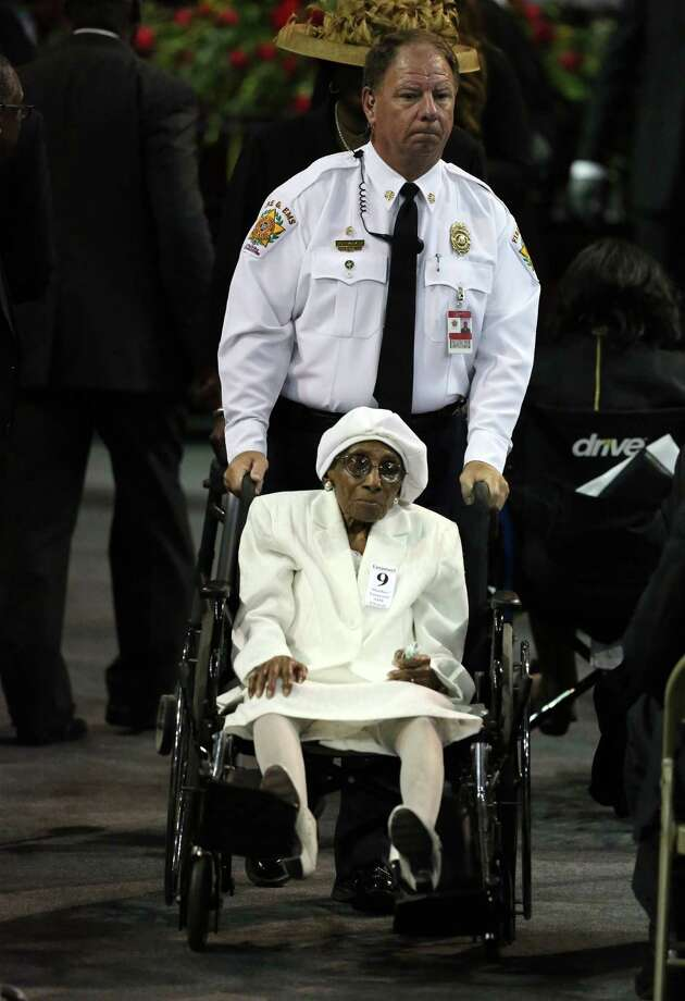 A woman is assisted into the arena before the funeral service for Sen. Clementa Pinckney, Friday, June 26, 2015, in Charleston, S.C.  President Barack Obama will deliver the eulogy at Pinckney's funeral Friday at College of Charleston's TD Arena near the Emanuel AME Church, the scene of last week's shooting.   (Grace Beahm/The Post And Courier via AP) Photo: AP / The Post and Courier