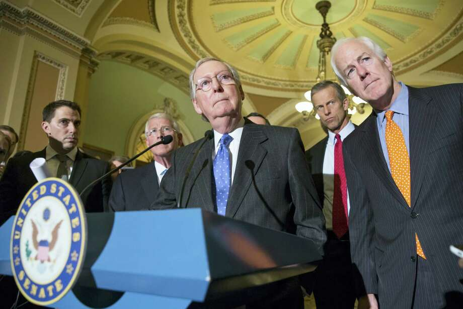 Senate Majority Leader Mitch McConnell of Ky., center, joined by starting second from left, Sen. Roger Wicker, R-Miss., Sen. John Thune, R-S.D., and Senate Majority Whip John Cornyn of Texas, speaks with reporters on Capitol Hill in Washington on Feb. 23, 2016, following a closed-door policy meeting. Senate Republicans, most vocally McConnell, are facing a high-stakes political showdown with President Barack Obama sparked by the recent death of Supreme Court Justice Antonin Scalia. Republicans controlling the Senate — which must confirm any Obama appointee before the individual is seated on the court — say that the decision is too important to be determined by a lame-duck president. Photo: AP Photo/J. Scott Applewhite  / AP