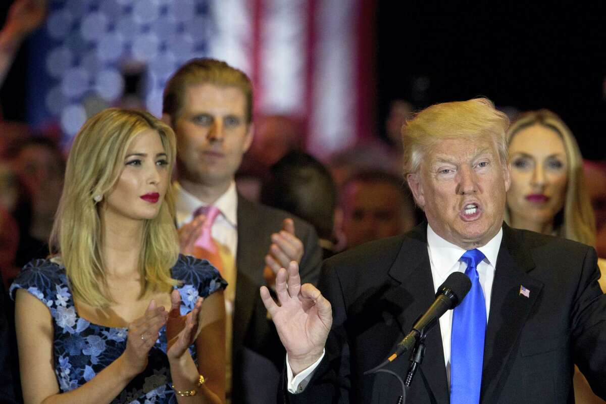 Republican presidential candidate Donald Trump is joined by his daughter Ivanka, left, and son Eric, background left, as he speaks during a primary night news conference, Tuesday, May 3, 2016, in New York.