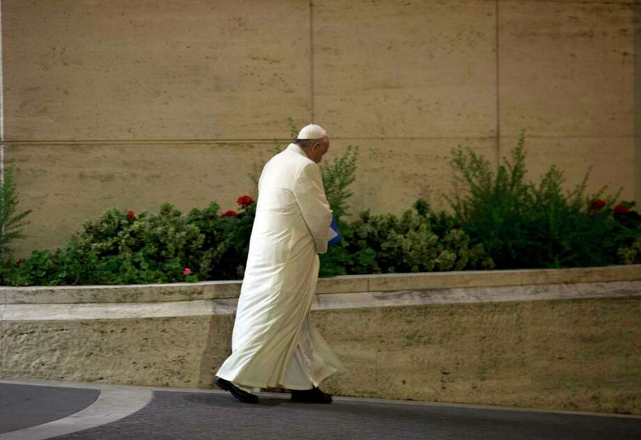 Pope Francis leaves at the end of the Synod of bishops, at the Vatican, Saturday, Oct. 24, 2015. Catholic bishops were voting Saturday on a final document to better minister to families following a contentious, three-week summit at the Vatican that exposed deep divisions among prelates over Pope Francis' call for a more merciful and less judgmental church. Photo: AP Photo/Alessandra Tarantino   / AP